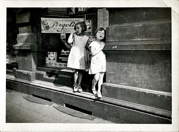 Two Girls Outside German Drug Store, c. 1930s