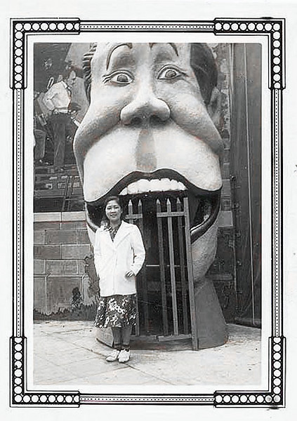 Woman Posing in Front of Novelty Storefront, c. 1945. Gelatin Silver Print Snapshot