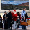 American Airlines passengers, including a Santa Claus look-alike Kelly Ferrell of Big Spring, Texas, wait in a TSA line at Terminal D at Dallas-Fort Worth International Airport, Thursday, December 8, 2016. Ferrell, who plays Santa Claus but doesn't have a sleigh, was flying to a holiday gig.