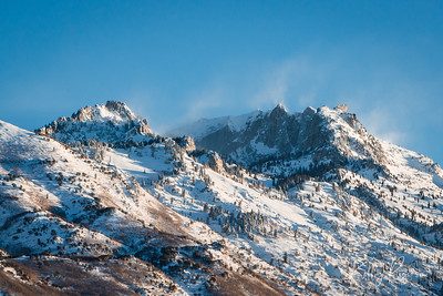 Winter morning, New Year's Day January 1, 2019. Wind blowing the snow around Lone Peak of the Wasatch Mountains, Utah.