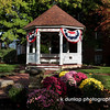 """10.19.09 = Just a little slice of Americana today,  I've been traveling so much lately it's nice to shoot something right up the road.  This is the gazebo in front of the famous Golden Lamb in Lebanon, Ohio.  The Golden Lamb Inn, is the oldest Inn in Ohio, since 1804.  Over 12 Presidents have stayed there and countless famous historical figures.  A famous English writer and poet arrived one day; Charles Dickens. <br /> <br /> """"Have a heart that never hardens and a temper that never tires, and a touch that never hurts.""""  Charles Dickens<br /> <br />  <a href=""""http://www.goldenlamb.com/index.php?page=Home"""">http://www.goldenlamb.com/index.php?page=Home</a>"""