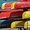 03.03.09 = I was looking through my all my photo's here in my journal and noticed that there was no COLOR!   It's gray here in Ohio so I have been on the lookout for COLOR. Today I found it.  I was on my way home from my appointments when I passed this canoe rental.  All the canoes were stacked and stored for the winter.  I turned the car around and pulled over off the side of the road and walked down a little hill to get this shot.  Ha, i was dressed for work, and my heals were sinking into the ground.....need to keep my boots in the car.