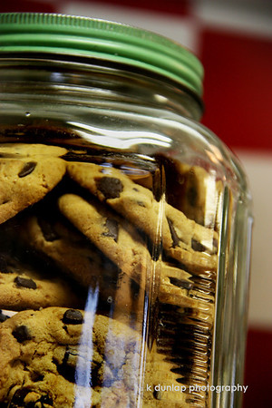 "11.30.09 = Ahh, the chocolate chip cookie.  What could be better than a chocolate chip cookie? To me, it's the ultimate finger food.  You don't need a fork like with cake or pie.  You can dunk it in milk or tea or even hot coffee if you like. You may like them soft or slightly crunchy; with or without nuts. You can make them in square bars or traditional rounds.  You can make them large or small and eat one big one or three small ones.  There is no better dough just to eat raw, right out of the bowl…Again I ask, what could be better than the chocolate chip cookie?  How do you like your cookie? <br /> <br /> ""A balanced diet consists of a chocolate chip cookie in each hand.""  ~Unknown"
