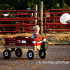 "08.02.09 = One sweet ride!  This is one happy little dude with his shades on, kicked back in his wagon.  I sometimes wish, someone would pull me around at these things.<br /> <br /> ""The difference between men and boys, is the price of their toys."""