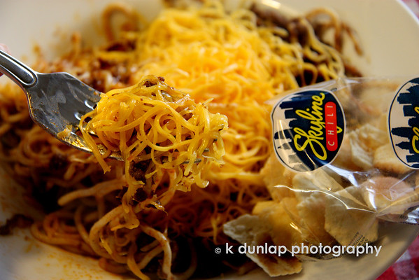 "08.17.09 =  SKYLINE CHILI!!!  To follow yesterdays post, my topic this week is local food.  Even if you have never been to Cincinnati, you may have heard of ""Cincinnati Style Chili"".  We like our chili a little bit different here; over speghetti. A 3-way is spaghetti topped with chili and cheese; 4-ways, the same with your choice of beans or onions added and a 5-way, both beans and onions added.  The chili is not a tomato base or a Texas style chili it has a touch of cinnamon and some say, chocolate in it.  The secret family recipe is kept in a safe!  My favorite are the cheese coneys; little hot dogs with chili, mustard, onions topped with a mountain of cheese.  Oh, and dont forget the oyster crackers on the side!  Skyline chili, a hometown favorite!  <br /> <br /> ""My mother's menu consisted of two choices: Take it or Leave it!""  Buddy Hackett<br /> <br /> Read more about it:  <a href=""http://en.wikipedia.org/wiki/Skyline_Chili"">http://en.wikipedia.org/wiki/Skyline_Chili</a>"