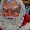 "12.22.09 = Scary Santa!!  Well, this has to be one of the scariest Santa's I've ever seen.  He looks a little troll or elf like to me.  I'm not so sure I would want him sliding down my chimney on Christmas Eve.  I think this Santa has scared many a small child.  Why is it that so many children are afraid of Santa Clause?  You see all those little one's waiting in line at the mall to see Santa and when they finally have their turn, all they do is cry.  Interesting when you think about it.  <br /> <br /> ""What do you call people who are afraid of Santa Claus?  Claustrophobic.""  <br /> <br /> (Sorry, I know it's lame but I just had to say it!)"