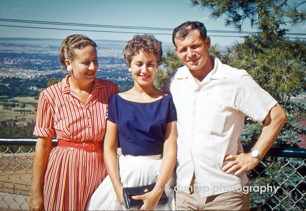 """05.24.13 = Flashback Friday - 1957 Family Treasure<br /> <br /> I'm digging way back in the family archives today.  As I was searching for an image to use today, I came across this one of my mom with her mom and dad.   It was taken in the summer of 1957 in Colorado, not long after my parents were married.  I know it's not the best image; my mom and grandmother's eyes are closed or squinting, but on the other hand, it is the best image;  it's one of the only photographs I have of just the three of them together.  Over time it's not about having the best posed images of the people we love, it's about just having that image of them to look back and remember.  So this holiday weekend, photograph the ones you love and don't worry so much about  the technique but the unique moments that you capture.  In 56 years someone will treasure it!<br /> <br /> """"Rejoice with your family in the beautiful land of life!""""  Albert Einstein"""
