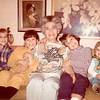 "03.22.13 = Flashback Friday - Hugs<br /> <br /> A few weeks ago, my sister and I went to a mid-century modern furniture show and one of the booths reminded us of the furniture in my  grandmothers house, and it made me think of this photo and my grandmother.  We started talking about her house, her furniture and fabrics.  It's funny how you remember the strangest things about a place and time. I can remember the tall plants she had in her sun room and those cool bamboo like chairs. But mostly, I remember the way she smelled when she went to hug you goodbye. A little of her perfume and makeup would rub off on you and linger with you for hours, as if to hold on to you for as long as she could and give you that memory of her.  Every once in a while, I catch that smell in the air and know that she is still there, lingering, and I remember. <br /> <br /> ""A hug is a great gift - one size fits all and it's easy to exchange.""  Unknown"