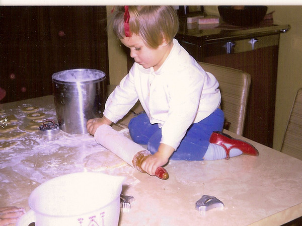"12.13.13 = Flashback Friday - Holiday Traditions<br /> <br /> Whether you put your tree up the day after Thanksgiving or Christmas Eve, it's fun to carry on traditions. Yep, that's me, of what was probably my first holiday baking experience.  I must have been about 2 1/2 here.  This is one of those holiday traditions I love; baking!  I think I'll do a little baking this weekend and keep this family tradition going. Have a great weekend everyone and enjoy those traditions or start new one's! <br /> <br /> ""Traditions can become fragile when passed.""  unknown"