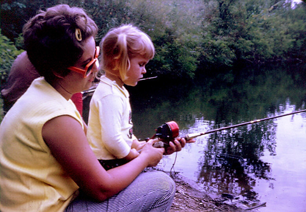 "05.09.10 = The little things.  <br /> <br /> Yes, that's me and my mother is teaching me to fish.  I had to be only about four in this photo. I can't really say that I remember that moment that was captured here so many years ago, but I do remember the special times over the years that my mom and I spent together one on one.  I remember her taking me dance class and conversations we would have on the way there and home.  I remember her staying up late and sewing me a special dress for my confirmation and our talks together.   I remember her holding my hand in the emergency room for the injury of the week.  I remember shopping together for a prom dress and shoes.  I remember her smile on my wedding day and how she called me every day during my divorce.  What I don't remember are all the times she was angry at me or I was mad at her. I don't remember all the times she told me 'no"" I couldn't go somewhere or have something.  Those are the things that just fade away and don't really matter over time.  What does matter are the little moments and the time we spend together.  Thank you mom for all the little things that have made my life so wonderful.  I love you with all my heart!  Kris :D<br /> <br /> HAPPY MOTHER'S DAY!"