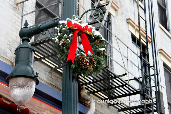 "12.30.10 = A touch of Christmas<br /> <br /> Can you believe it?  I'm at a loss for words today!  I just liked how this traditional Christmas wreath was in contrast to the fire escape.  That's all today, nothing else…  I'm even having a hard time getting a quote for the today.  What's wrong with me?  More coffee. <br /> <br /> ""It is Christmas in the heart that puts Christmas in the air.""  W.T. Ellis"