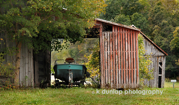 "10.08.10 = Boat in the barn<br /> <br /> ""The leaves fall, the wind blows and the farm country slowly changes from the summer cottons into its winter wools.""  Henry Beston"