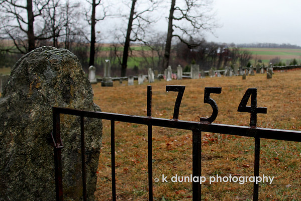 "12.16.10 = 1754<br /> <br /> This is the gate to a cemetery across the lane from the church I posted yesterday.  As I sit here this morning and watch the snow falling, I wonder what it was like to live in 1754.  Something to think about today.  <br /> <br /> ""The ultimate measure of a man is not where he stands in moments of comfort and convenience, but where he stands in times of challenge and controversy.""  Martin Luther King Jr."