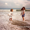 "07.29.11 = Flashback Friday 1995 Emerald Isle, North Carolina<br /> <br /> Since we are in the prime of Summer, I thought I needed to reach back and grab a beach photo for Flashback Friday and this is one of my favorites.  This one is of my two nieces, Katie and Kirby at ages 5 and 3, who are now, 21 and 19, boy how time flies.  As I remember, it was evening and we had all had a long day on the beach.  Margaritas were in the blender for all of us adults and we had a dance party going on up on the deck.  Their favorite song that summer was ""Big Girls Don't Cry"" by Frankie Valli and The Four Seasons.  I can't tell you how many times we had to play that song for them!  However, it did come in handy when we had to get a splinter out of Kirby's hand.  Such great times and memories and photographs to prove it. <br /> <br /> ""Our memories of the ocean will linger on, long after our footprints in the sand are gone."""