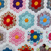 "08.02.11 = Quilted with love<br /> <br /> Even in this crazy heat, somehow my quilts feel light and cool, and strangely, in the winter, they feel heavy and warm.  How is that possible?  I was thinking about this at 3:40 this morning when I couldn't sleep.  Is it the cotton material?  Is it the weight of the fabric?  Does it have something to do with the quilting? Or is it because they are all little squares? What?   As I tossed and turned the question over in my semiconscious mind, I quickly dozed back off, no closer to solving the scientific make up and physics of my quilt.  I mostly just felt the love that was stitched in every square and a big hug from my grandmother.  <br /> <br /> ""Carefully cut pieces of our lives, held together by a common thread; that's quilted love."" Kristan Dunlap"