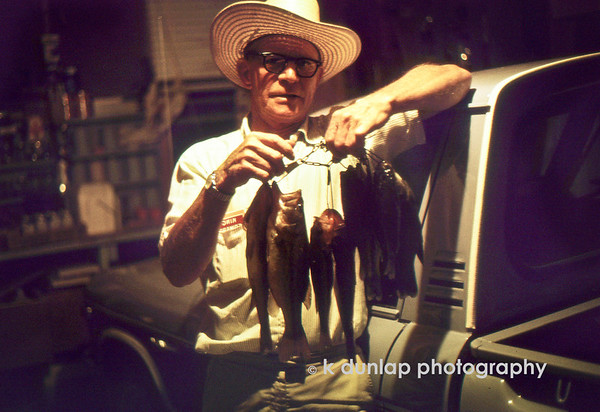 "02.03.12 = Flashback Friday – Fishing <br /> <br /> I love this photo my father took of my Grandfather after one of their many days out fishing.  Whenever we went to the country house for a visit, my dad and grandfather always had a least one day to themselves to go fishing.  My grandfather would have several spots staked out far in advance so as to not embarrass themselves and bring nothing home.  Looks like this trip was a success.  I can remember them coming home and telling us about the days adventures; where they went and what crazy character they ran into along the way.  The dinner table was always full of tall tales, laughter and of course, fresh fish.  Good times and great memories. <br /> <br /> ""Never let the truth get in the way of a good story.""  Jim Dunlap"
