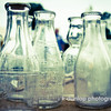 "05.02.12 = A second look<br /> <br /> I've been getting ready for a few big art shows coming up and I've been spending some time going back through photo's to see if there is anything I've missed that I can use.  I've always liked this shot of the milk bottles to go with my vintage collection, but I never felt I had the right angle or something was just off.  I played around with it a bit and now I'm kind of  diggin' it. I don't know if it will go to print or not but it was worth a second look. <br /> <br /> ""Did you ever stop to think and forget to start again?""  Winnie the Pooh"