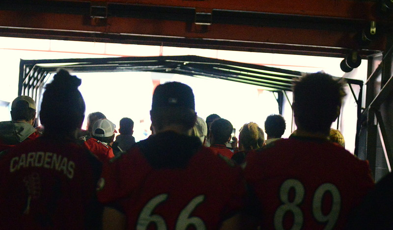 Loveland's football team walks out of the tunnel to the field at Broncos Stadium at Mile High as part of their tour of the facility on Tuesday before taking part in the championship press conference. (Mike Brohard/Loveland Reporter-Herald)