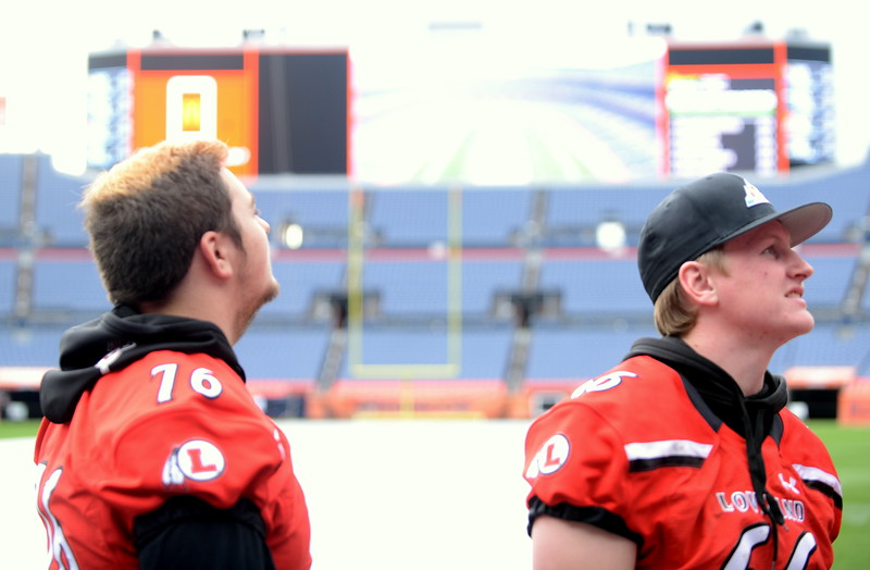 Loveland's Brayton Jones (76) and Logan Cocke look around Broncos Stadium at Mile High during Tuesday's tour of the facility as part of the championship press conference for the 4A and 5A football championship games on Saturday. (Mike Brohard/Loveland Reporter-Herald)