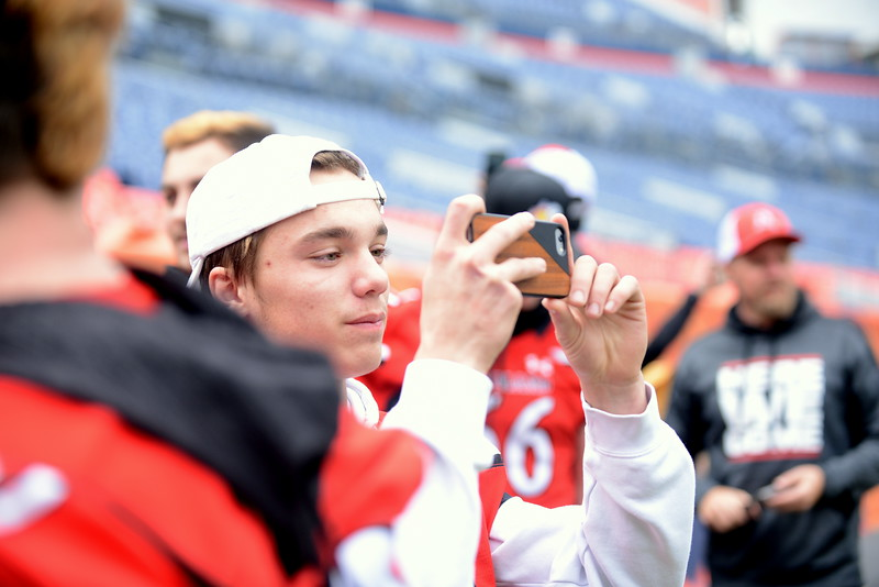 Loveland's Zack Hansen takes pictures of Broncos Stadium at Mile High as the team toured the facility Tuesday, the site of Saturday's 4A state championship with Skyline. (Mike Brohard/Loveland Reporter-Herald)