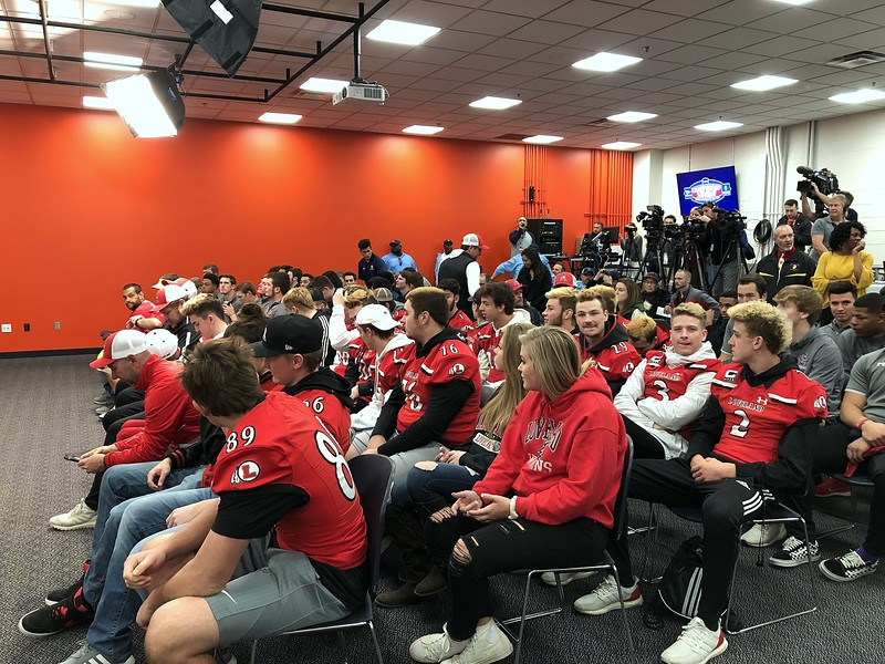 Loveland's football team takes their seats for the 4A/5A state championship press conference on Tuesday at Broncos Stadium at Mile High. (Mike Brohard/Loveland Reporter-Herald)