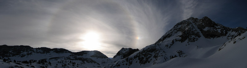 "This was taken in March of 2006 when Nick and I skied Red Slate Couloir...seen to the right...the obvious chute cutting diagonnaly down Red Slate Mtn. <br /> <br /> Next to the mountain is a 22 deg Circular Halo... as described here.<br /> <a href=""http://www.atoptics.co.uk/halo/circular.htm"">http://www.atoptics.co.uk/halo/circular.htm</a><br /> <br /> The pallid sun accompanied by a Circular Halo, along with a Sun Dog on the right side...<br /> <a href=""http://www.atoptics.co.uk/halo/parhelia.htm"">http://www.atoptics.co.uk/halo/parhelia.htm</a><br /> AKA... parhelia <br /> <br /> ...caused by ice crystals in the upper atmosphere."