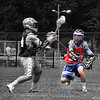 "This selective color photo of my nephew, ""Morgan Lloyd,"" playing defense won the 2012 MADLAX Photo Contest."