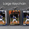 Keychains are assembled by inserting two prints back to back in a protective plastic casing for long lasting durability.