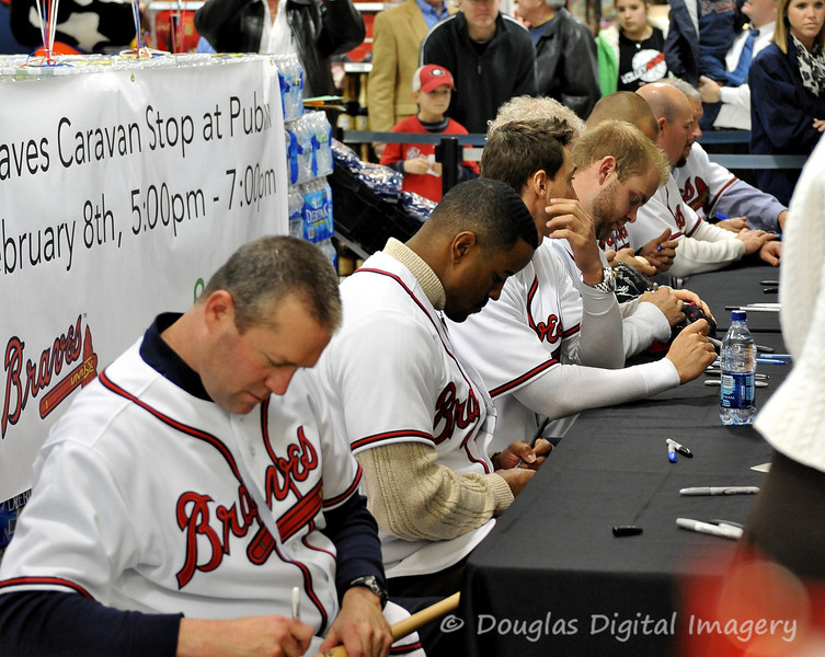 February 7th - February 13th<br /> <br /> The 2010 Atlanta Braves Caravan made a stop at the Publix in Suwanee, GA on Monday 2/8.  This is a shot of all of the Braves personnel that were there on hand to sign autographs for the fans.  The Publix workers said that people started lining up for the autograph session at 10 AM that morning.  The Braves did not arrive until 5 PM.  Those in attendance from closest to furthest: Roger McDowell; Brian Jordan; Jordan Schafer; Brian McCann; Don Sutton; Jo Jo Reyes; Mike Dunn; and Bobby Cox.<br /> <br /> D700; 28-70 f/2.8 AF-S