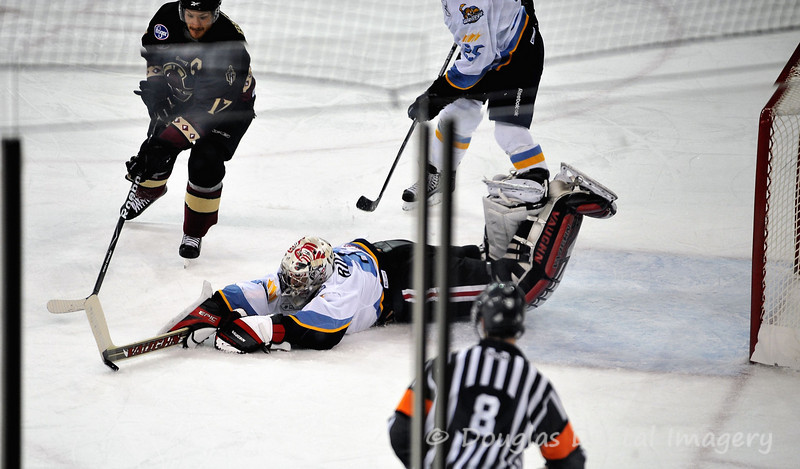 Januaray 31st - February 6th<br /> <br /> We went to the Gwinnett Gladiators game versus the Toledo Walleye on Saturday 2/6.  I liked this shot (even though the glass is in the way) because it shows you a goalie's worst nightmare.  The goalie dived for the puck to cover it up and missed it (you can see the puck at the end of his stick).  However, luckily for him there wasn't another player around close enough to score a goal as he was able to quickly recover.<br /> <br /> D700; 80-200 f/2.8 AF-S