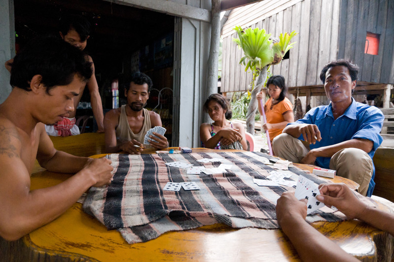 The men of Koh Roung village spend the majority of each day drinking and gambling. With little work to go around, the card and bingo games provide entertainment and help pass the time. If the Royal Group allows the village to remain where it now stands, the villagers hope to work in the coming tourist establishments.