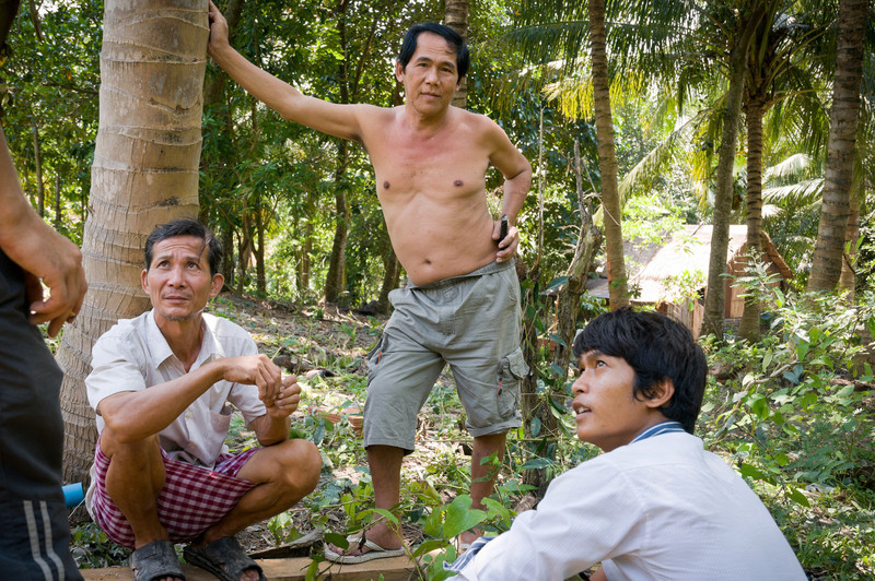 Dennis Funke the Dive Shop manager(just out of frame to the left), speaks to Mr. Sroy (left) and Mr. Boon (center) through Davi the translator (right). With all the support the Dive Shop provides to the villagers, Dennis is frustrated with Mr. Boon's reluctance to offer government help as well. This particular conversation focused on the unused incinerator. Mr. Boon was also convinced to contribute wood to the nearby toilet project.