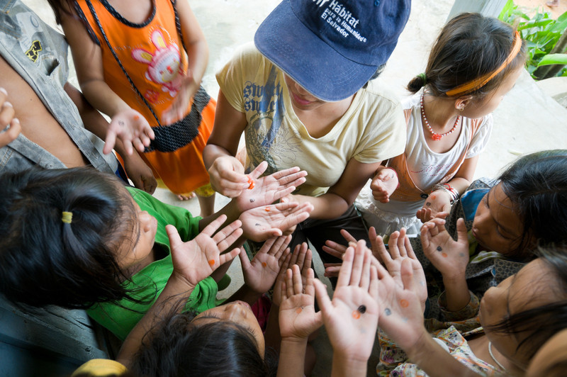 A member of Operation Groundswell, a Toronto-based volunteer and travel organization, stamps childrens' hands after an English lesson. It is crucial that they are prepared for the work, and foreign tourists, the coming resorts will bring. The Royal Group is currently building an island road and airport, with plans including a marina and golf course as well. The building is on a 25-year timeline.