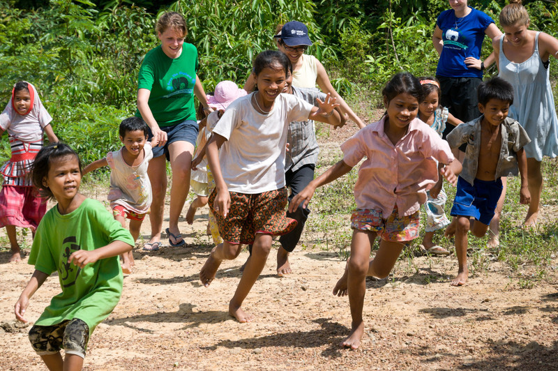 Local children play with their temporary English teachers, a touring group from Toronto-based Operation Groundswell, after a forty-five minute lesson. The Dive Shop strives to provide English teachers whenever possible.