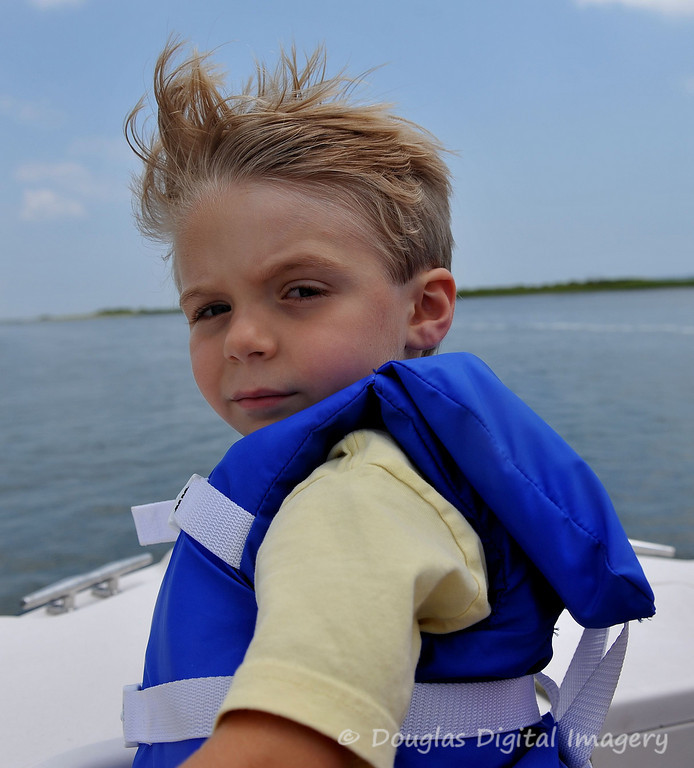 Picture for the week #2 of 7/12 - 7/18.<br /> <br /> This is my other nephew Cole who is 4.5. This is him taking his first boat ride just off the shore of Swansboro, NC where he lives. He's showing off what a stiff headwind will do to your hairdo.<br /> <br /> Shot with D700; 28-70mm f/2.8 AF-S<br /> 28mm; 1/1250s; f/6.3; ISO 200