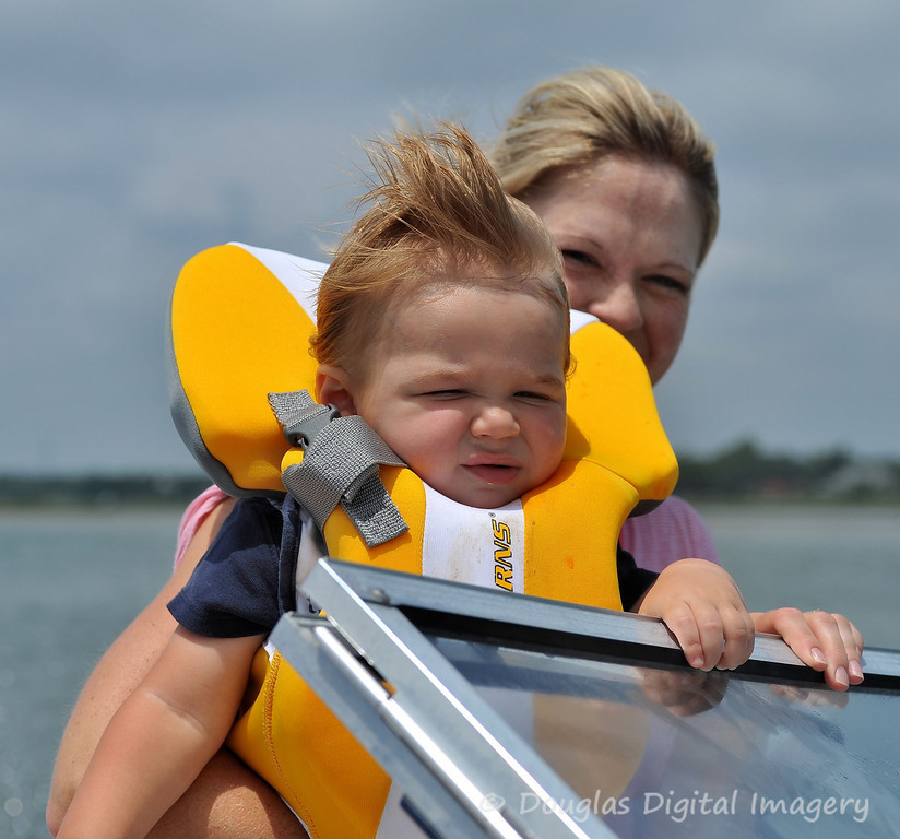 Picture for the week #1 of 7/12 - 7/18.<br /> <br /> This is my nephew Nolan who just turned 1 on 7/11/09.  This is him taking his first boat ride just off the shore of Swansboro, NC where he lives (that's my sister holding him up).<br /> <br /> Shot with D700; 28-70mm f/2.8 AF-S<br /> 65mm; 1/3200s; f/5.6; ISO 200