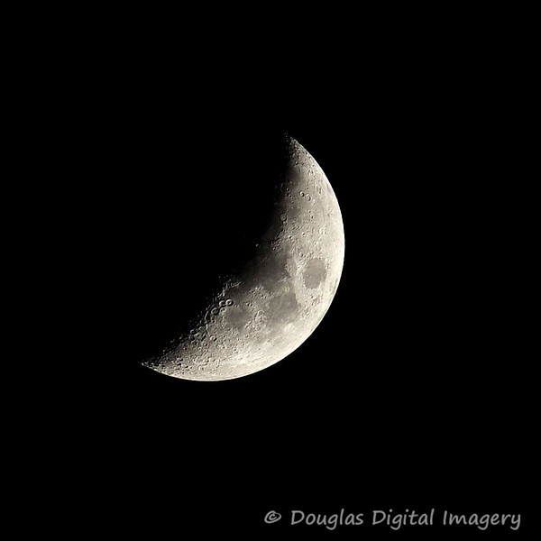Picture for the week of 9/20 - 9/26<br /> <br /> A picture of the almost half moon from late in the evening.  I took the shot on a tripod on my back patio.<br /> <br /> Shot with D700; 300mm f/2.8 AF-S II w/1.7x TC attached<br /> 500mm; 1/250s; f/5; ISO 200
