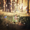 Beautiful Child Fairy Girl in Magical Woods