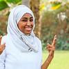 A healthy and happy African Muslim woman in hijab is showing her happy face after an outdoor workout in a white shirt in Dubai, UAE.