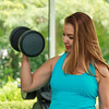 Woman is exercising in gym with dumbbells.