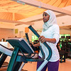 An African Muslim woman is exercising alone in gym.