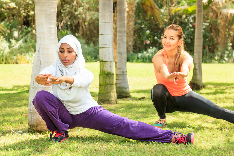 Two women one in hijab and Muslim are training fitness in a park in Dubai, United Arab Emirates.
