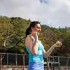 Woman tennis player practice in tennis court in Dubai.