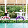 Two women practicing yoga outdoor in Dubai, UAE.
