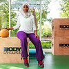 A healthy and happy African Muslim woman in hijab is enjoying a day in gym after workout.