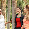 A group of three girls are getting together after a fitness session while talking.