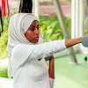 An African Muslim woman is posing with a weight in hand in a gym after a workout in Dubai, UAE.