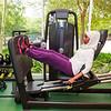 Beautiful Muslim Woman Using a Gym Machine.