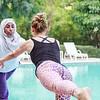 Two women practicing yoga outdoor in Dubai, UAE.