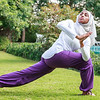 Beautiful Muslim Lady in hijab is Practicing Yoga Outdoor in Dubai, UAE.